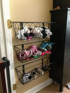 My daughter who has 3 children ages 3 mo, 1 yr old and a 2.5 yr old, bought 3 metal flower boxes and put them in the laundry room. They are the right height for the toddlers to put put their shoes away as soon as they enter thru the garage. They also remove their shoes at any door and pick them up to put away:) This little DIY idea makes it easier for them.