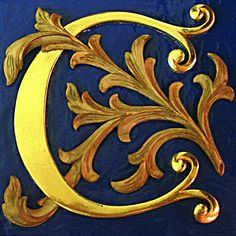C in gold on navy blue