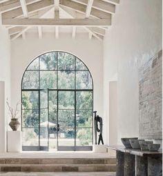 Arched steel door marble foyer. front door love