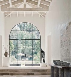 Arched steel door marble foyer. front door love