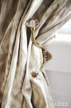 coat hook used to tie back curtains