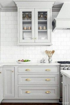 Looking for some grey and gold kitchen inspiration? Here's a sneak peek at our grey and gold kitchen renovation + the images that inspired me! Two Tone Kitchen Cabinets, Kitchen Cabinet Design, Interior Design Kitchen, Kitchen Cabinetry, Kitchen Backsplash, Backsplash Ideas, Backsplash Design, Subway Backsplash, Bakers Cabinet