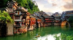 "Every year, armies of young backpackers flock to the ancient town of Fenghuang (which literally means ""Phoenix"") in Hunan province."