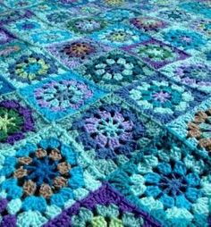 shades of blue granny square- I really like the pinwheel squares and the fact that its not perfect- looks like something achievable by melva