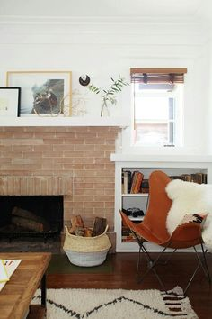 vintage chair, brick fireplace, artwork collection, books ... cosy