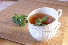 Mint Tea on Bamboo Placemat Styled Stock Photo by PerceptionStock