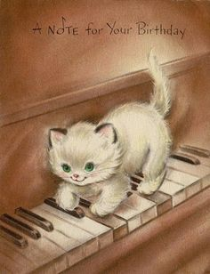 Birthday kitten playing a note