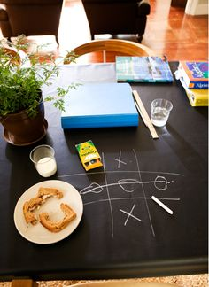 tic tac toe chalk top table - photo by melanie acevedo