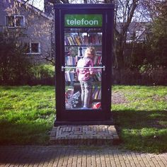 Refurbished telephone booth and library! Source: http://instagram.com/marcelkalmeijer