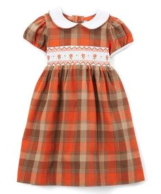 This Orange & Brown Smocked Plaid A-Line Dress - Infant, Toddler & Girls is perfect! #zulilyfinds
