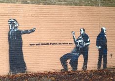 Banksy? Read article.  A politically charged stencil painting on the former Alfred Priestley school building at 1619 Leonidas St. uptown has characteristics of the British street art star Banksy