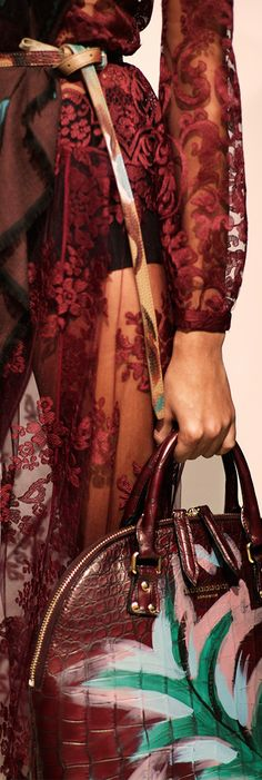 Layers of deep fuchsia and elderberry - a glance backstage before the Burberry A/W14 runway