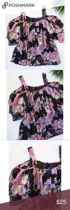 Floral cold shoulder top Beautiful floral cold shoulder top from Boston Proper. This top has a stunning floral pattern, button up front, and the perfect flowy fit! Could easily be dressed up or down. Size medium, in excellent condition. Boston Proper Tops Tees - Short Sleeve