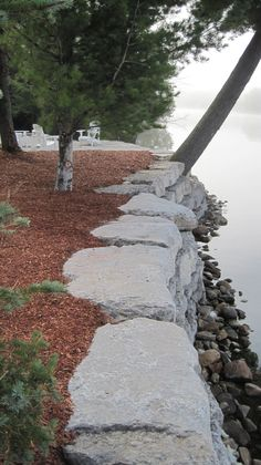 Retaining wall on pinterest armour stone retaining wall for Limestone landscape rock
