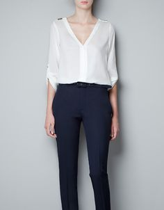BLOUSE WITH STUDDED SHOULDER