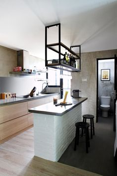 The kitchen island serves as a breakfast counter or food preparation table.