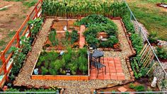 This garden area is fenced in, and it even has its own little table and chairs. The seating and secluded nature of the area, this vegetable garden is transformed into a sanctuary for the lucky green thumb to escape to.