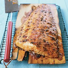 Grilling salmon  on a cedar plank is one of the tastiest ways to enjoy this omega-3-rich fish. A rub made from brown sugar, cayenne, and thyme pairs perfectly with salmon and really accents the natural flavors.Cedar boards for grilling are sold at gourmet food shops, housewares stores, and lumberyards. (Make sure the lumber hasn't been treated with preservatives or other chemicals.) The fish comes out smoky and moist. You'll never grill salmon the traditional way again.
