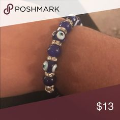 Evil Eye Beaded Bracelet The evil eye signifies protection and its is truly a fun fashion statement to wear. With fun spacer beads in the middle of the bracelet, they just to add a pop of sparkle. Evil Eye and blue beads are glass. Each bracelet is individually made and may vary slightly. Jewelry Bracelets