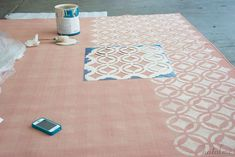 How to Paint a Rug – Can't find THE Right color? Buy solid and paint. Free-hand it or stencil for design. All it takes is wall paint.