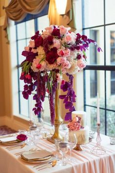 Pink and red centerpiece | Romantic Pink and Red Wedding Inspiration | see more: http://theeld.com/1KhIsIh