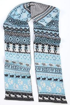 Keep your neck warm this winter with our delightful made in the USA kitty cat scarf. This blue fair isle patterned scarf features super cute cats doing what they do best. This women's scarf is a perfe