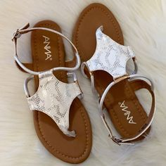 White Silver Snake Print Strap Sandals 8.5 Size 8.5!! Super cute and comfy White/Silver Snake Print Strap Sandals. Full size run available. Get your size while I have them in stock! Larger sizes sell out quickly. They come brand new in box. Never worn. They are True To Size! Available in sizes 6, 6.5, 7, 7.5, 8, 8.5, 9, 10. NO TRADES. No offers will be considered unless made through the offer button. Thank you! Boutique Shoes Sandals