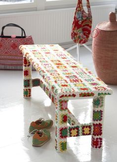 A delightful granny square covered bench seat found via Sanna & Sania