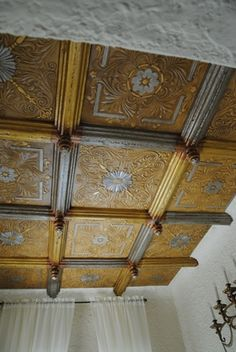 R 14 Victorian looking ceiling tiles  that are able to cover popcorn ceilings and add beauty to your room.