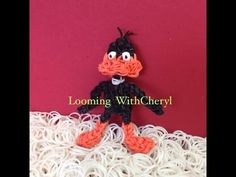 Rainbow Loom DAFFY DUCK. Designed and loomed by Looming WithCheryl. Click photo for YouTube tutorial. 06/28/14.