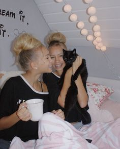 Lisa and Lena with their kitty! Follow me if you love them!