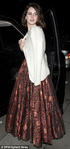It was 40 degrees: The pouty 26-year-old singer, born Elizabeth Grant, emerged from the celebrity hot-spot bleary eyed wrapping the top of her copper-floral gown with a cosy cardigan