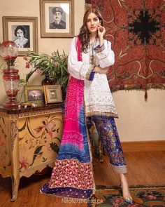 """Nilofer Shahid on Instagram: """"'Mir-e-Bahar' A magnificent, white cotton chickenkari shirt with traditional glass buttons, stunning sussi finishing, lapa and braids…"""" Silk Dupatta, Shades Of Blue, White Cotton, Braids, Kimono Top, Saree, Pure Products, Traditional, Shirts"""