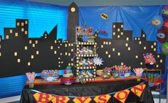 Superhero backdrop blue tablecloth from DT with black and yellow poster board to make a superhero city scene. Avengers Birthday, Batman Birthday, Superhero Birthday Party, 3rd Birthday Parties, Boy Birthday, Birthday Ideas, Superhero Backdrop, Superman Party, Superhero Baby Shower