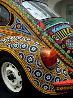 Huichol-style beaded VW beetle The photos don't make justice to this car, truly a work of art. The entire car is covered with elaborate designs made with tiny seed beads in the style of Huichol art. It's a sight to behold! Audi 100, Vw Bus, Vw Volkswagen, Volkswagon Bug, Vw Camper, Bugatti, Kdf Wagen, Retro, Vw Vintage