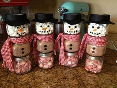 Snowman made from baby food jars  The top jar is filled with marshmallows. The middle jar is filled hot chocolate mix and the bottom jar is filled with mints.
