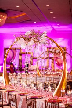 Dramatic centerpieces, branches, cyrstals, golden arches, hanging floating candles, orchids, wedding reception, Suhaag Garden