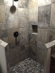Who'd thunk it?.  Putting our Silver Travertine French pattern on the wall.  It looks awesome.
