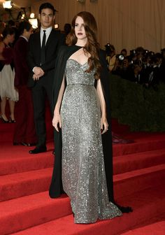 """Lana Del Rey - With a glamour that is equal parts sixties retro, seventies D.I.Y., eighties vamp, and nineties hip-hop, Lana Del Rey has fascinated audiences deeply enough to outlast the critical squabble that accompanied her 2011 debut single, """"Video Games."""" This past year has seen the Born to Die songstress prove not only her resilience but also an ability to edit her wistful image and find a stylistic solidity that has made real impact on the red carpet. Her Altuzarra cape at the Met…"""