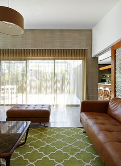 Modern residence clad in Colorbond Steel. Architects: Designed by Adam Dettrick Architects Modern Family, Home And Family, Living Area, Living Room, Lounge Suites, Mid Century Decor, Midcentury Modern, Brown And Grey, Modern Architecture
