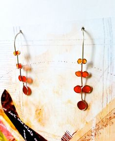 Silver and red with orange resin bubbles earrings by MuroJewelry, $22.00