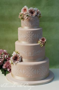 One hundred percent elegant, these lacy, beaded, and beribboned wedding cakes are as pretty as the brides whose receptions they grace.