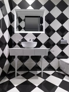 Black and White bathroom - bold graphic prints are a great way to loose the size in a small bathroom.