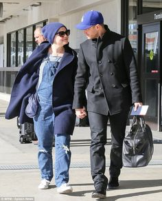 Ginnifer Goodwin was all smiles while showing off her baby bump as she arrived in Vancouver on Sunday hand in hand with her husband Josh Dallas, 36 dressed in denim overalls Once Upon A Time, Denim Overalls, Dungarees, Celebrity Babies, Celebrity Couples, Ouat, Ginny Goodwin, Josh Dallas And Ginnifer Goodwin, Snow And Charming