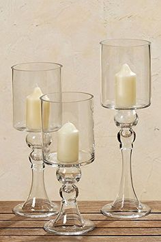 Spectacular Clear Glass Pillar Candle Holders 3 Pack 16, 13 3/4 and 12 Inches Tall, From Our Magnus Collection By Whole House Worlds Whole House Worlds http://www.amazon.com/dp/B009HNBL40/ref=cm_sw_r_pi_dp_VMjvwb048Z55A