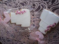 Cake cookie decorated with royal icing and lace