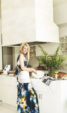 Gwyneth Paltrow's beautiful kitchen...i too am often found cooking in floor length gowns