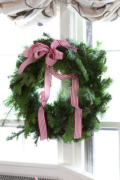 Tobi Fairley Holiday Decor, I love a simple green wreath and bow.