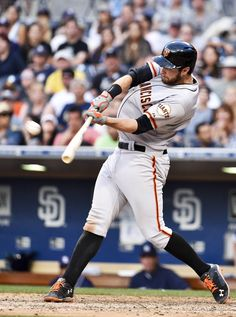 Brandon Belt #9 of the San Francisco Giants hits a two-run home run during the tenth inning of a baseball game against the San Diego Padres at Petco Park July 5, 2014 in San Diego, California.