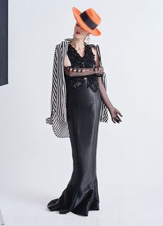 Birley wears Armani Privé waistcoat and skirt; Meadham Kirchhoff & Lilien Czech earrings; Cornelia James gloves; her own shirt and hat.